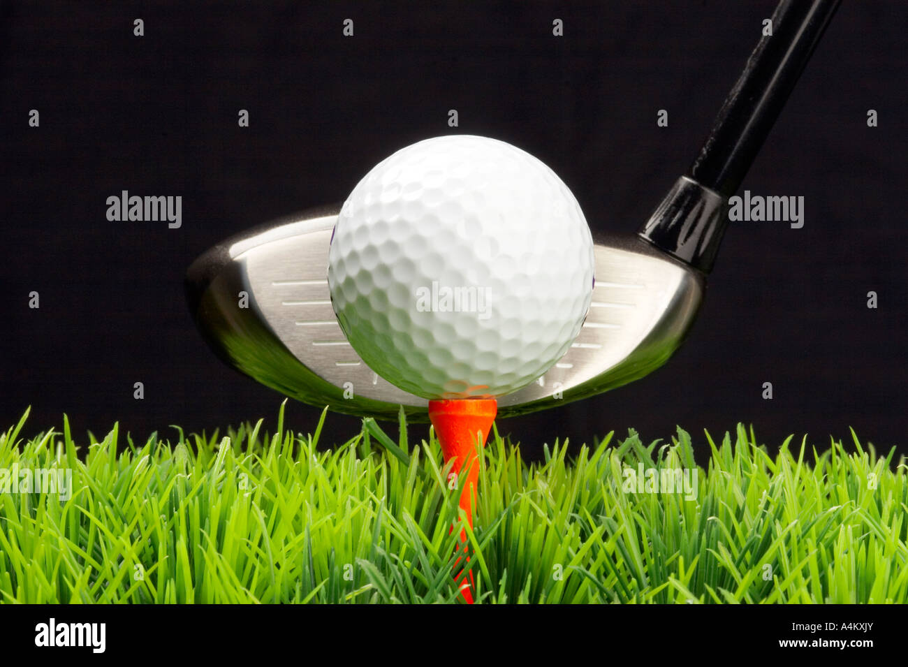tee off and driving the golfball Stock Photo