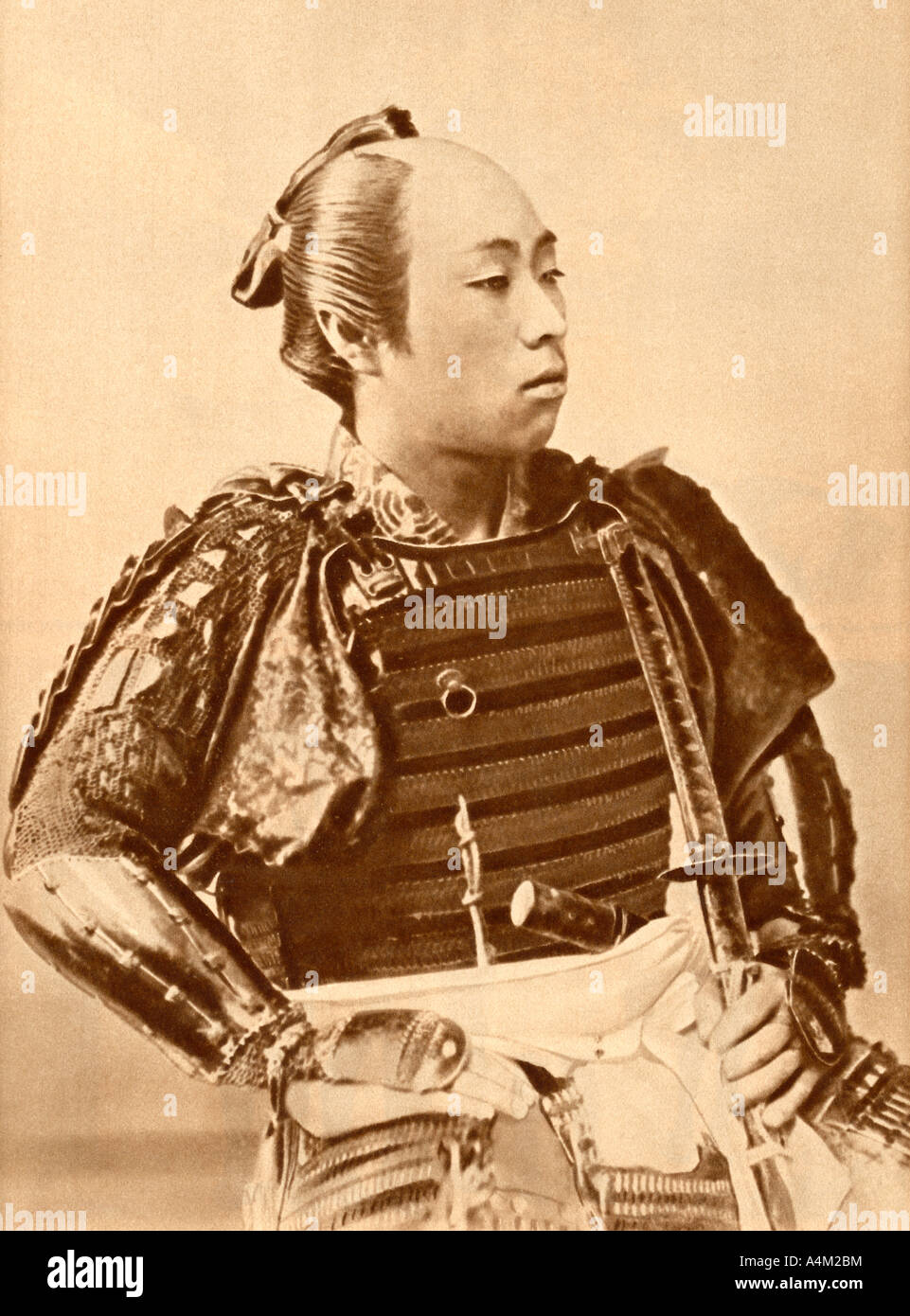 Historical Photograph of a Japanese Samurai Warrior in Traditional Dress - Stock Image