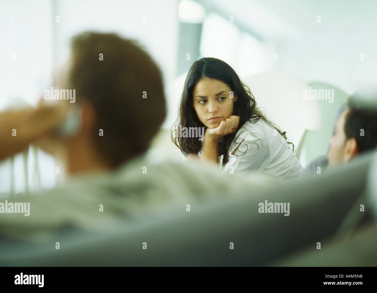 Young adults sitting together - Stock Image