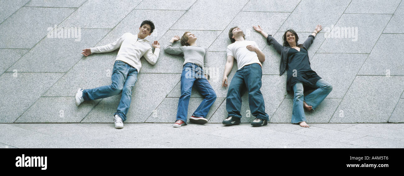 Young people striking poses - Stock Image