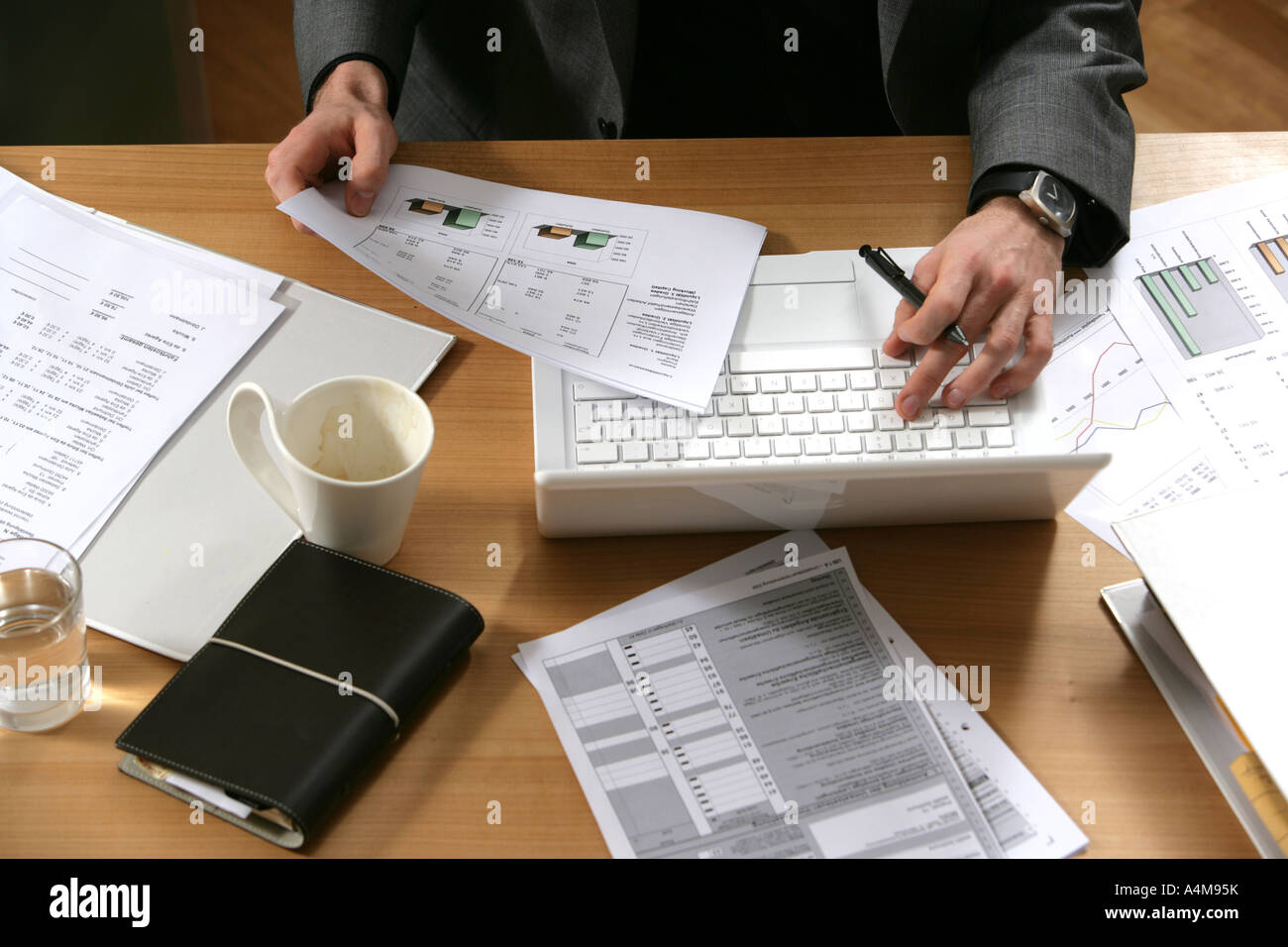 DEU Germany Man works in an office at a desk Stock Photo