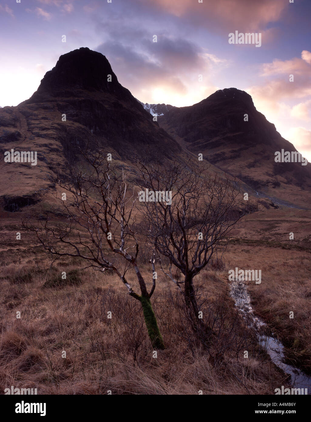 Gearr Aonach and Aonach Dubh viewed from the old road in Glencoe Stock Photo