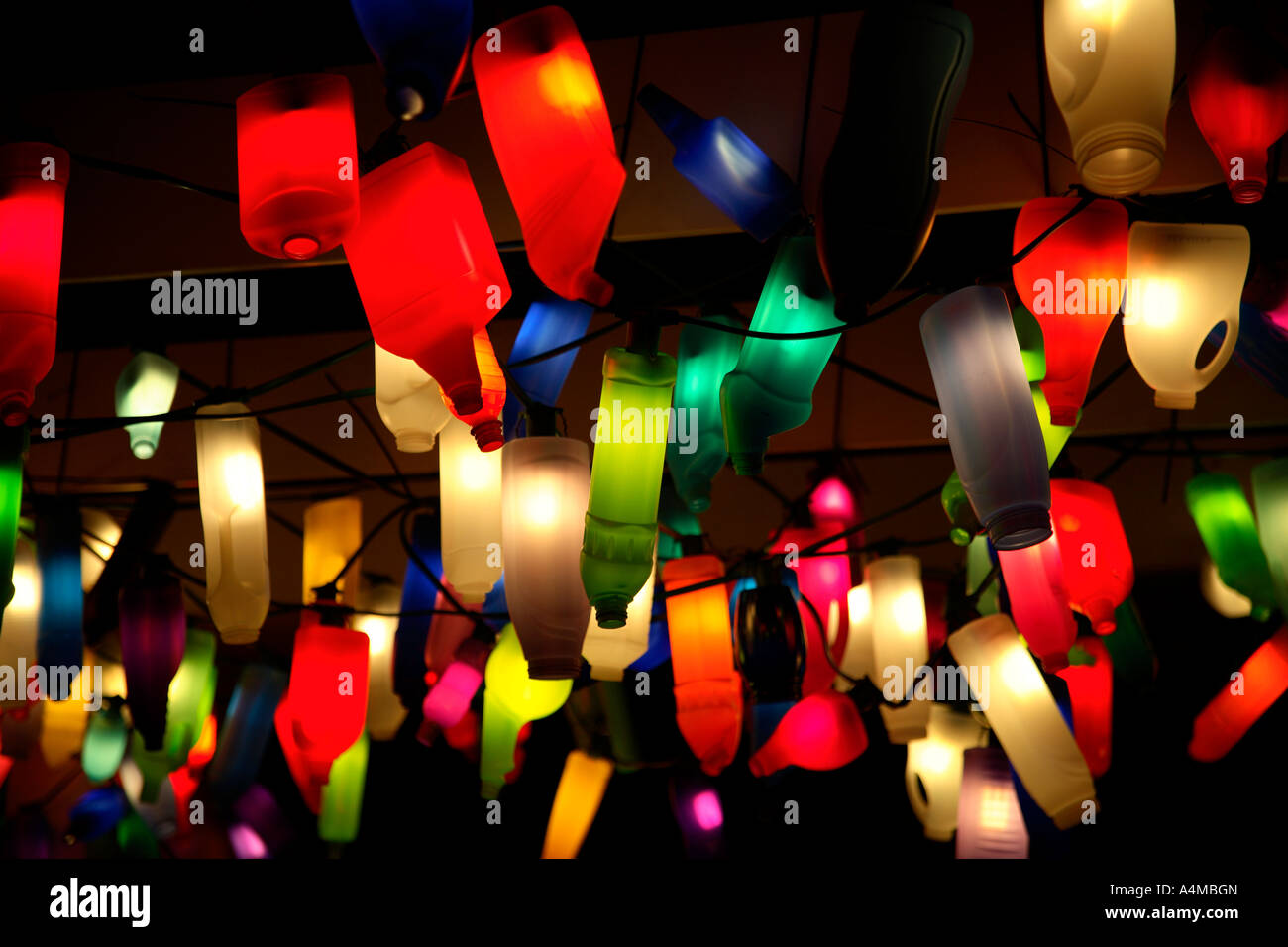 Plastic bottles used as lampshades at night. The South Bank, London, England, UK - Stock Image