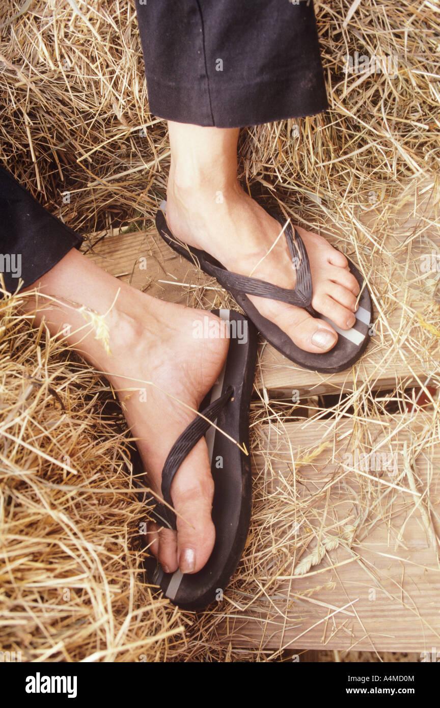 Woman's feet in flip-flops Stock Photo