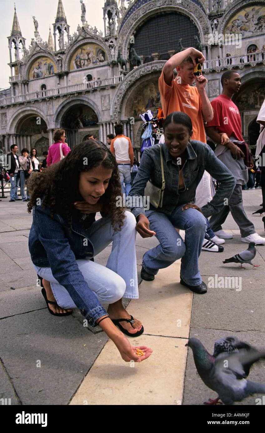ITALY VENICE Feeding pigeons at Piazza San Marco aka Saint Mark s Square Stock Photo