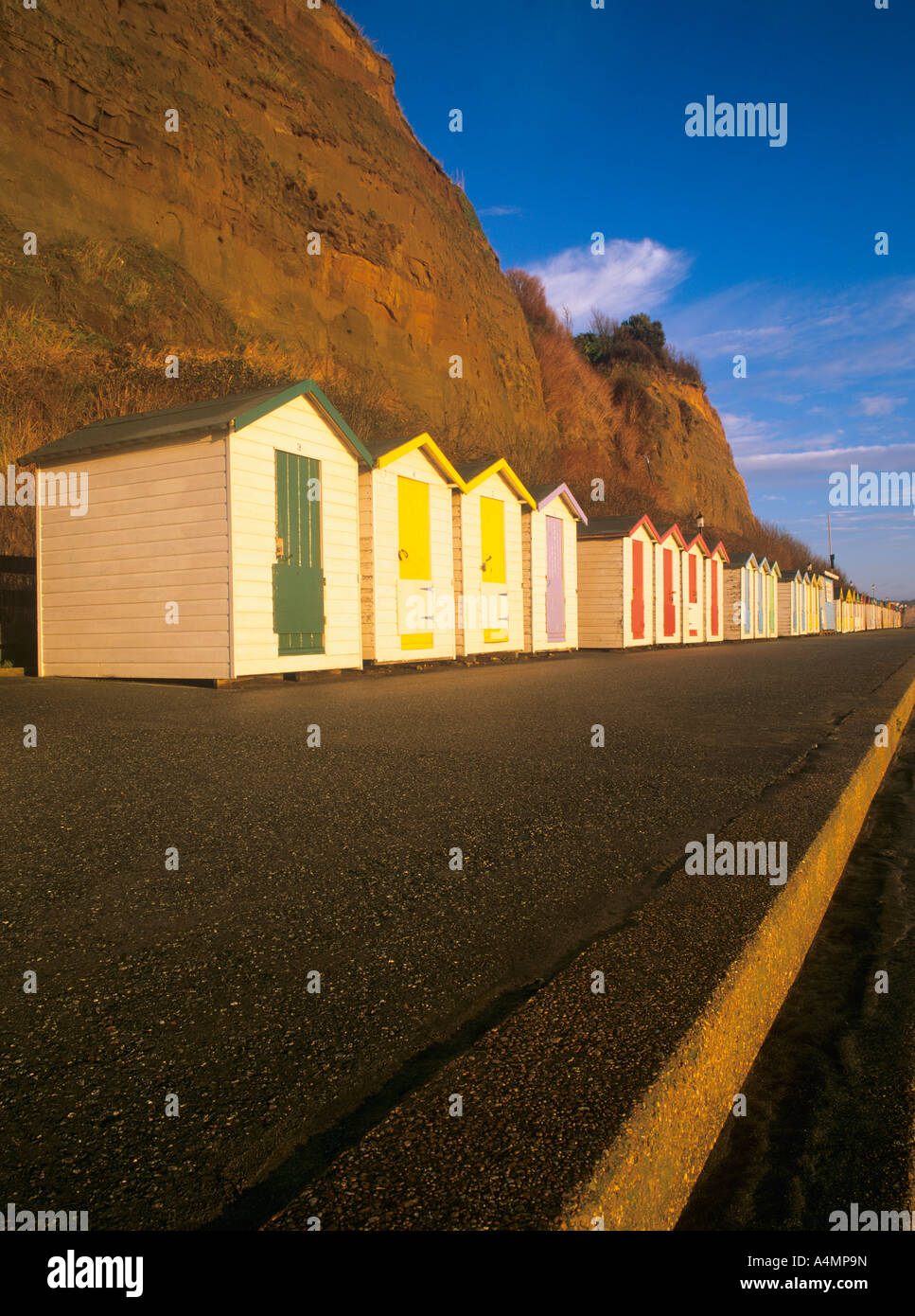 row of colourful painted beach huts on the esplanade promenade at shanklin isle of wight england uk - Stock Image