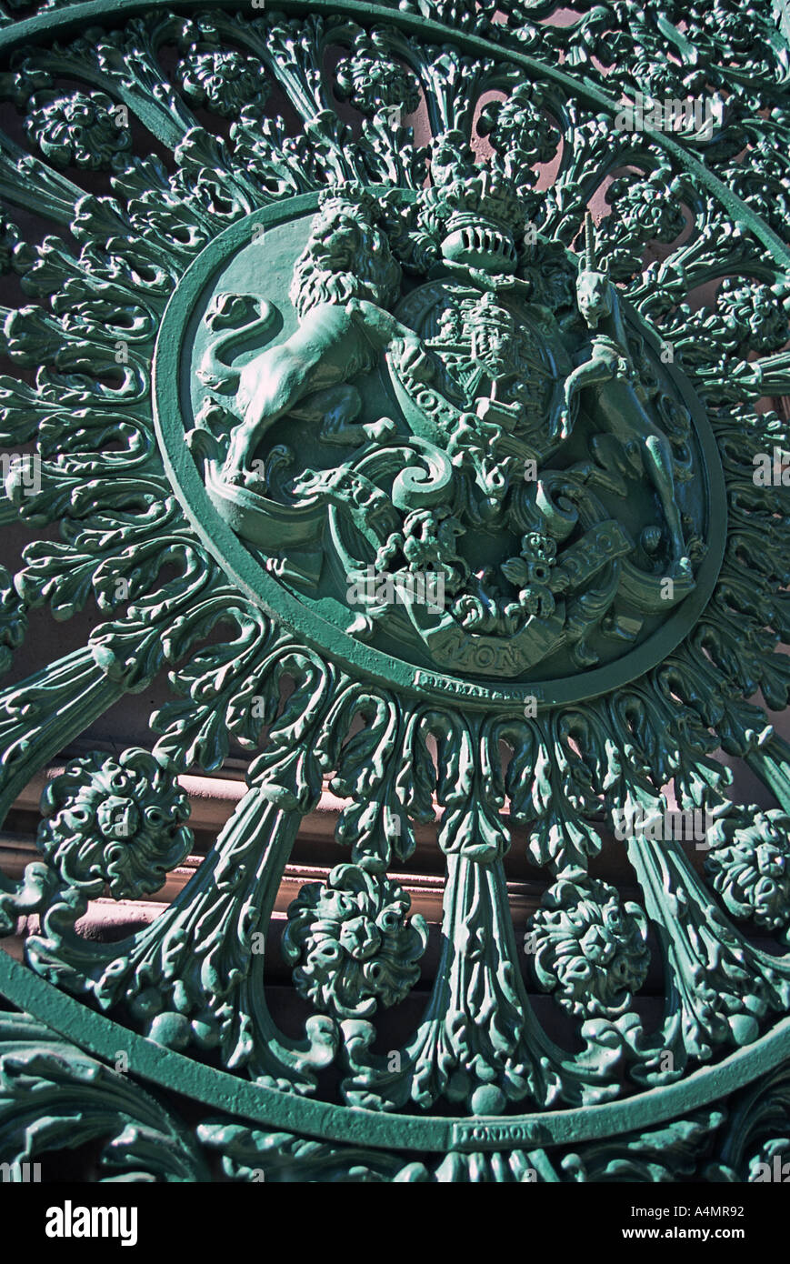 Detail of the heraldic royal insignia on the cast iron gate beneath the Wellington Arch Hyde Park Corner London England - Stock Image