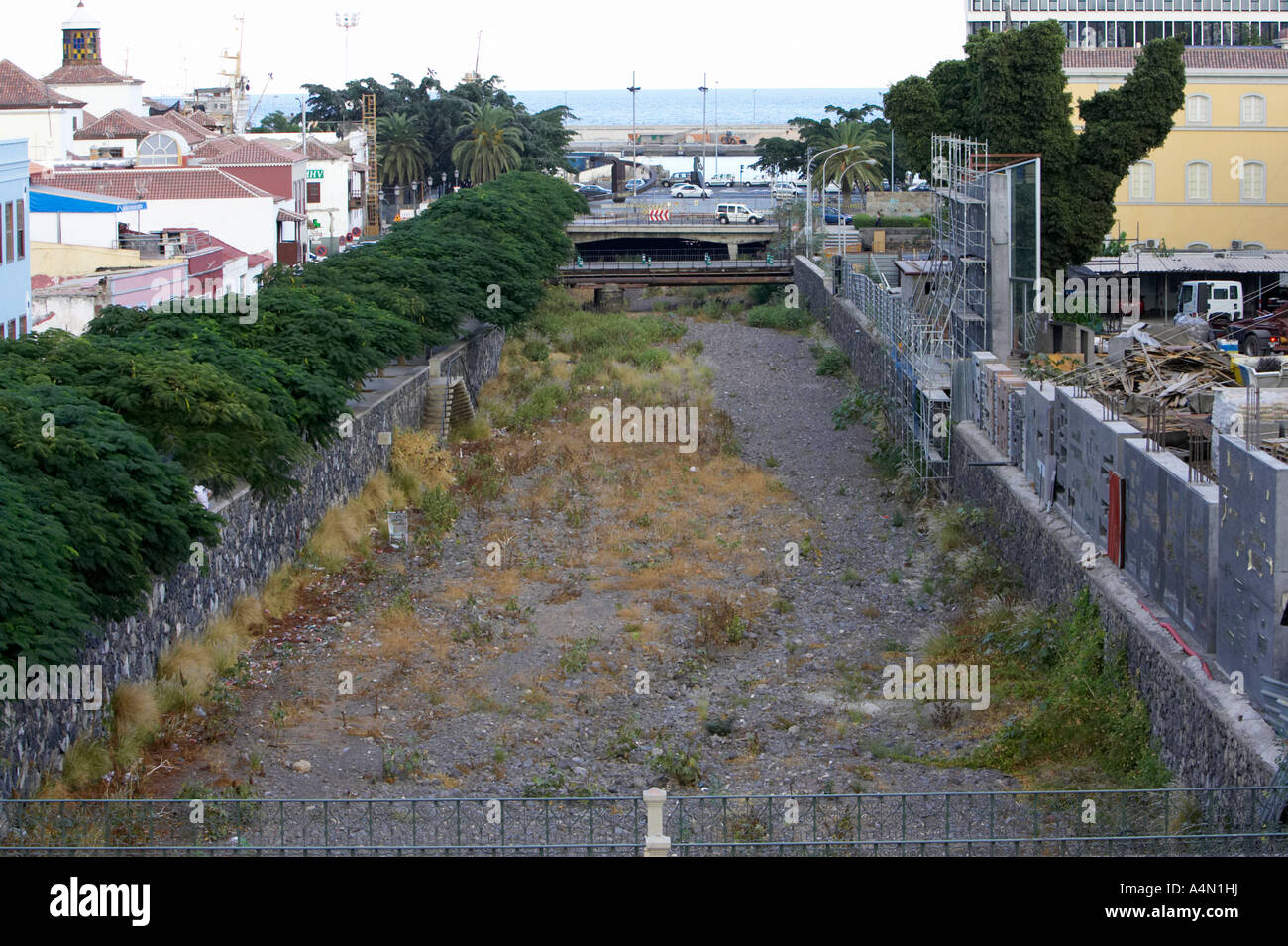 dried up river bed of Barranco De Santos running through the middle of Santa Cruz de Tenerife in the evening Stock Photo
