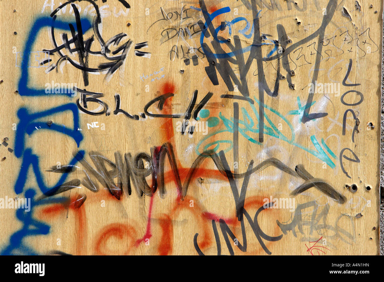 Various grafitti writing on wooden panel tenerife canary islands spain stock image
