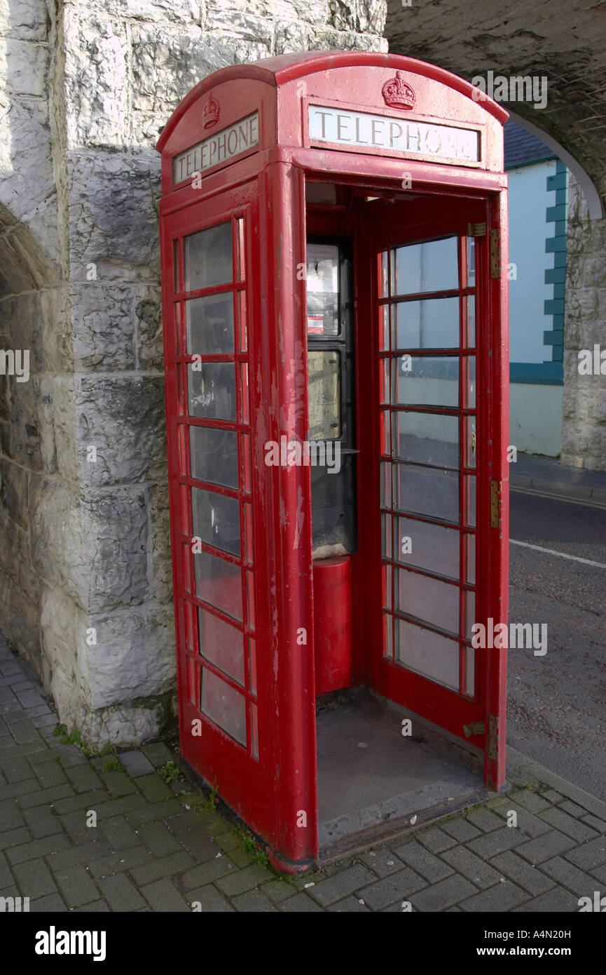 old style red telephone box with missing door in Carnlough county antrim - Stock Image