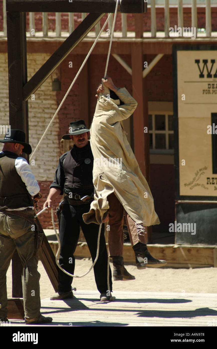man hanging in gallows at a film set recreation of a hanging  - Stock Image