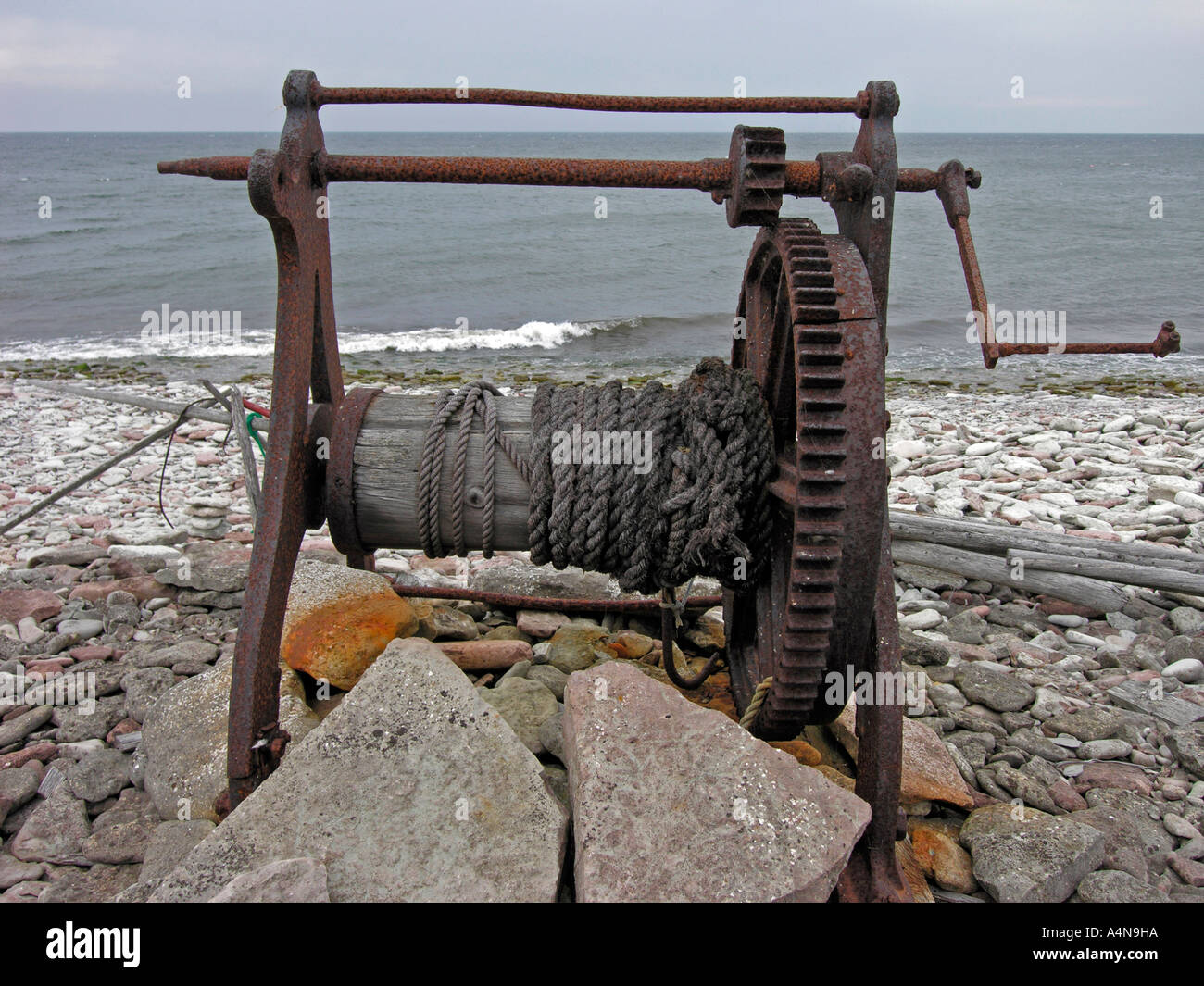 old wire rope hoist for pulling boats from water on the coast of ...