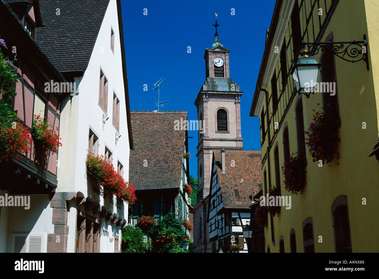 View to church tower and timbered houses Riquewihr Haute Rhin Alsace France Europe Stock Photo