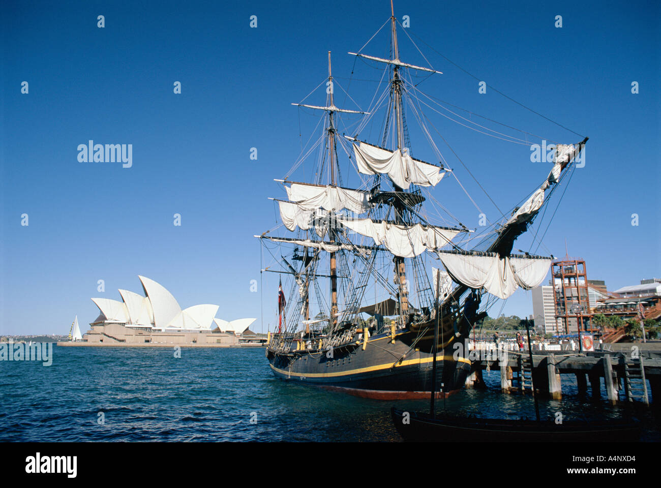 Replica of H M S Bounty and Sydney Opera House Sydney New South Wales N S W Australia Pacific - Stock Image