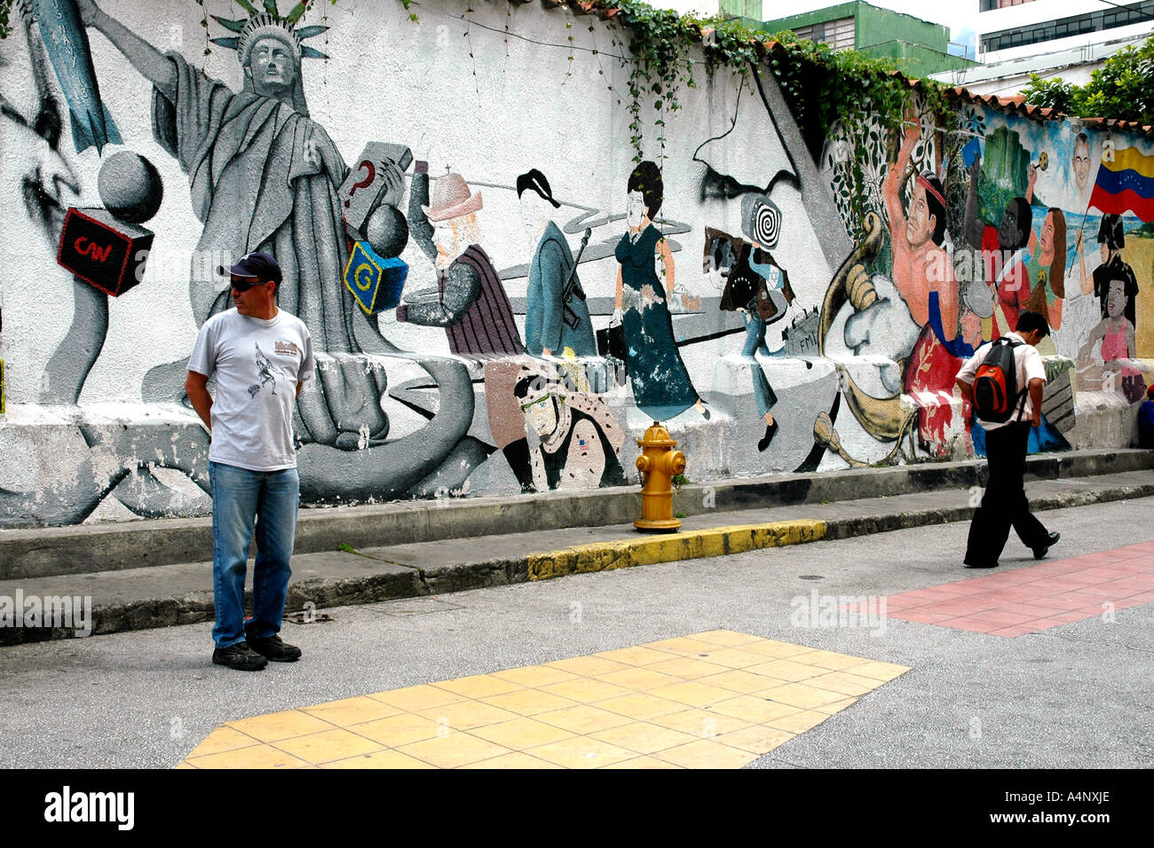 In Mérida, a Venezuela university city, a mural shows a Statue of Liberty as well as local references - Stock Image
