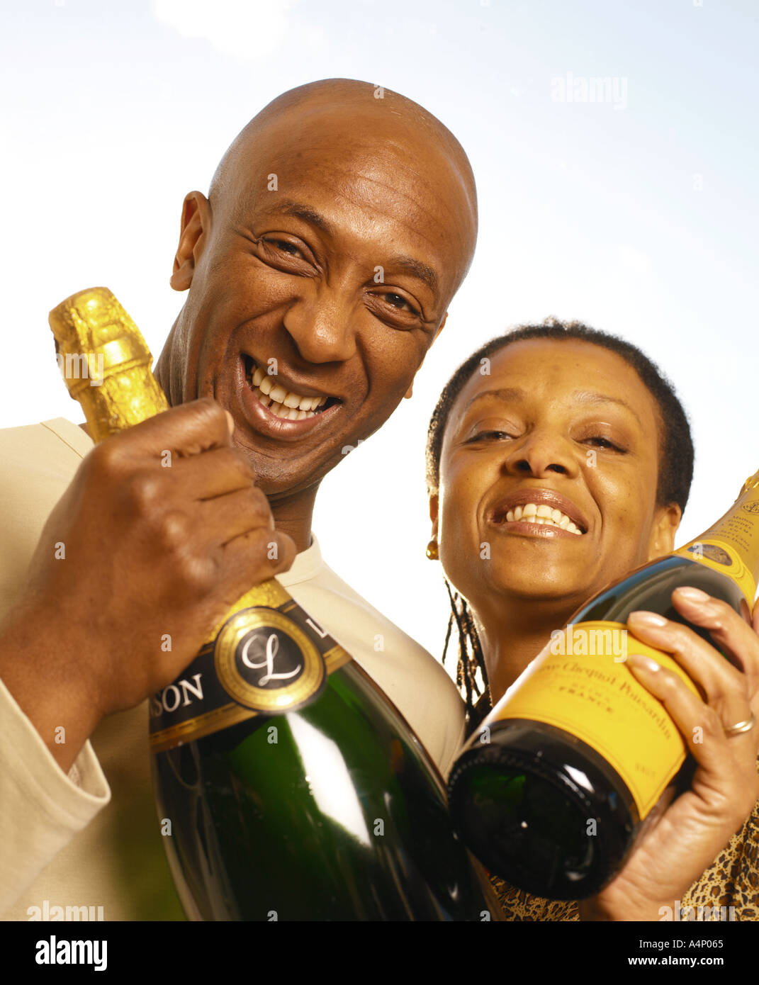 couple celebrating with champagne - Stock Image