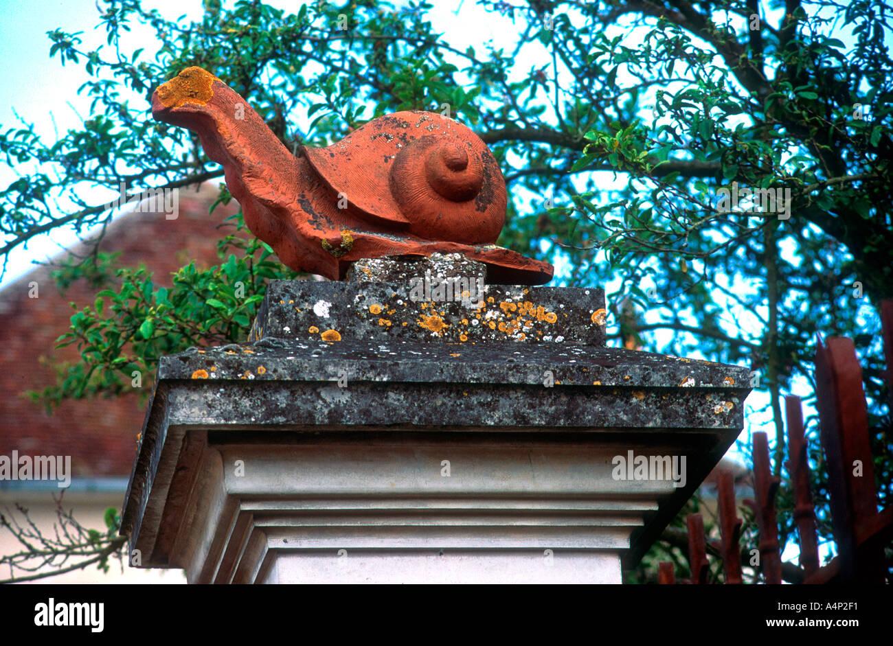 Terracotta snail on gatepost France - Stock Image