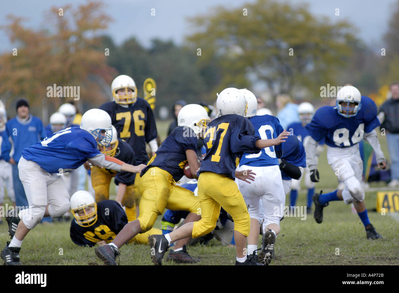 Middle School football action ages 12 to 14 male players - Stock Image