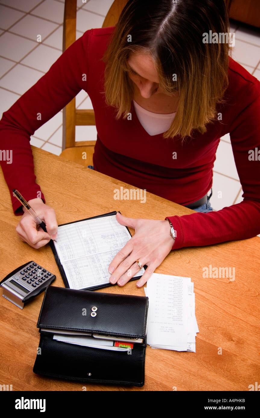 woman balancing checkbook stock photo 6343418 alamy
