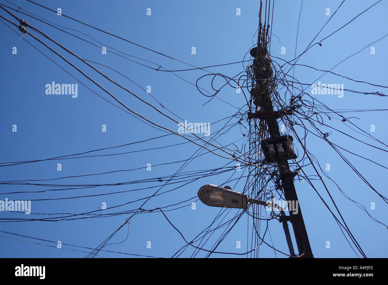 Electricity pole and street light complicated wiring on the pole or ...