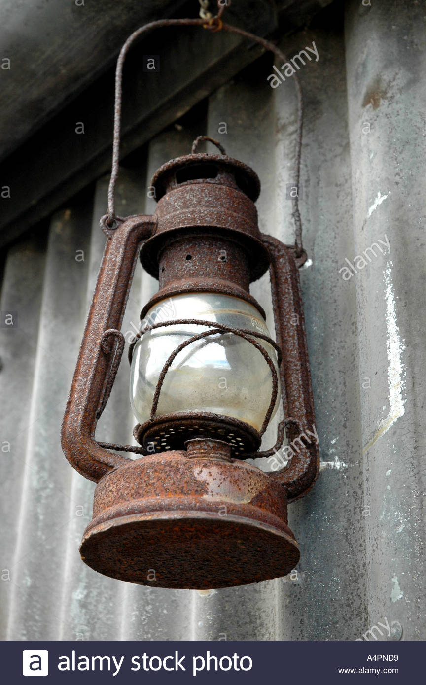Old rusty oil lamp - Stock Image