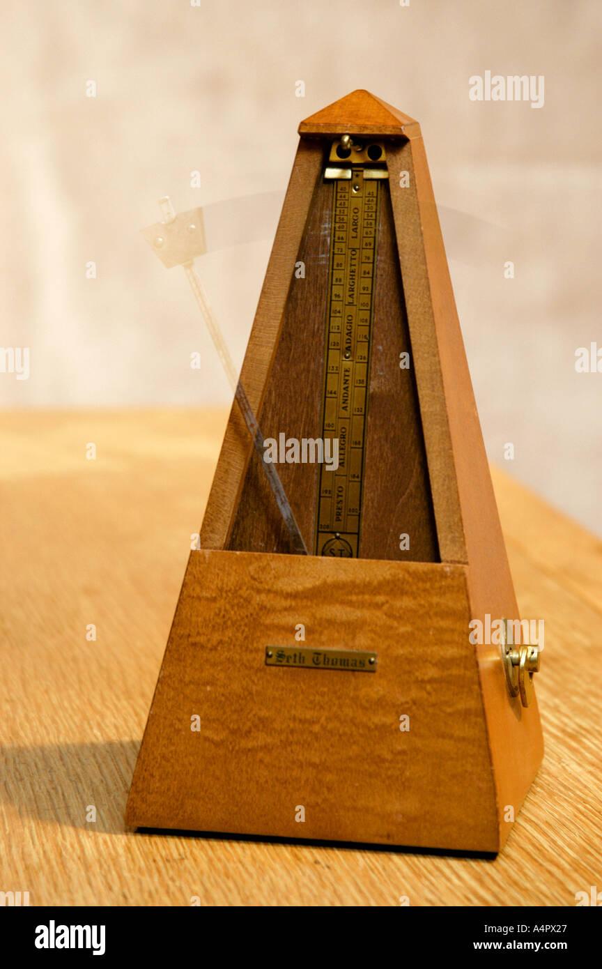 Seth Thomas wooden metronome set in motion timing music - Stock Image