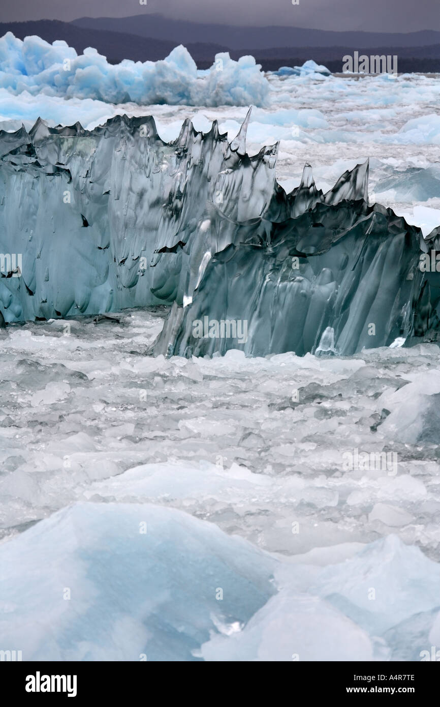 Jagged icebergs floating in sea ice near the San Rafael Glacier in Patagonia in Southern Chile South America - Stock Image