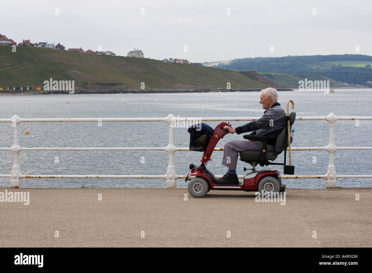 A man driving his buggy along the pier Whitby North Yorkshire England UK - Stock Image