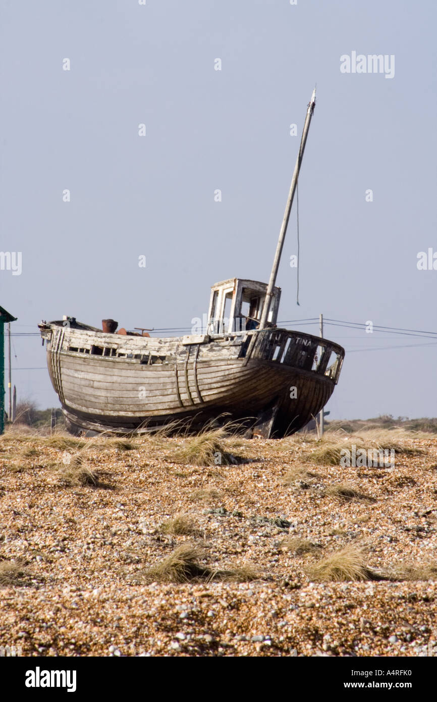 Abandoned wooden fishing boat on the shingle beach at Dungeness in Kent. Stock Photo