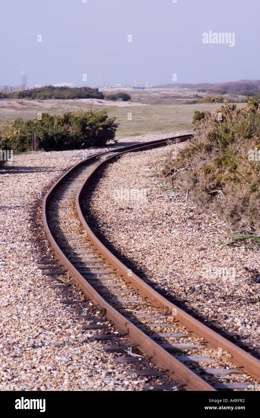 Narrow gauge railway lines disappear around a bend into the