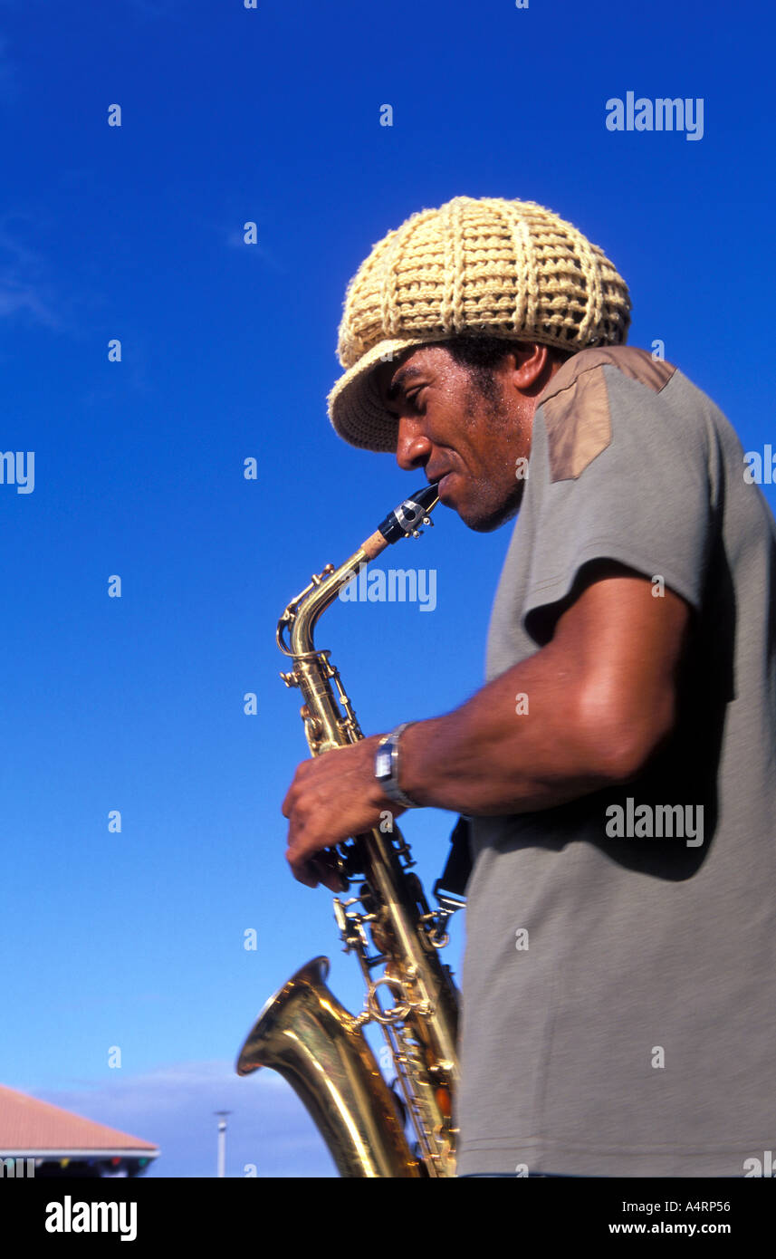 Young man playing a saxophone at Grand Riviere Fishing village in the northern tip of Martinique - Stock Image