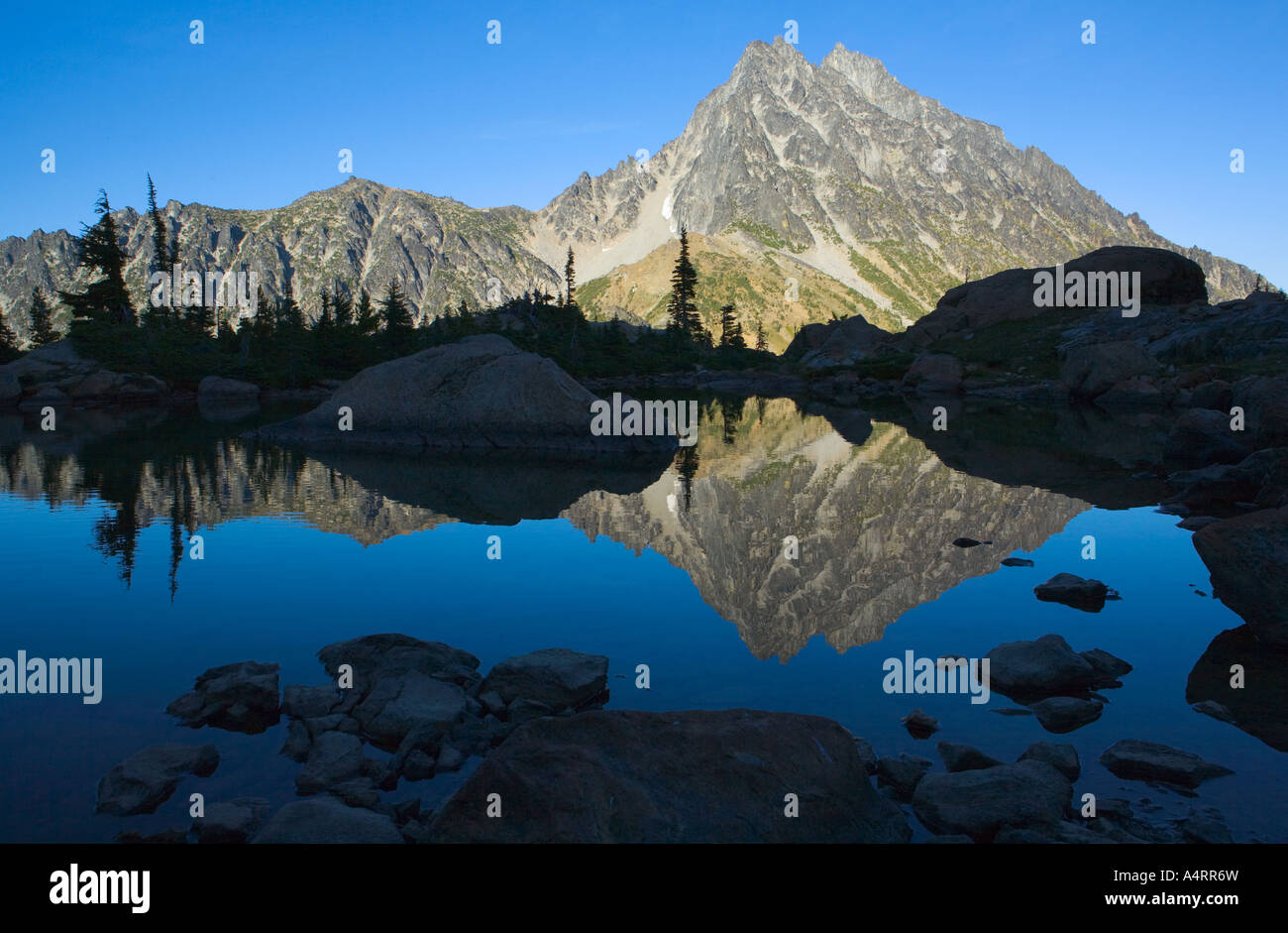Mount Stuart reflected in still water of Ingalls Lake Central Cascades Washington USA Stock Photo