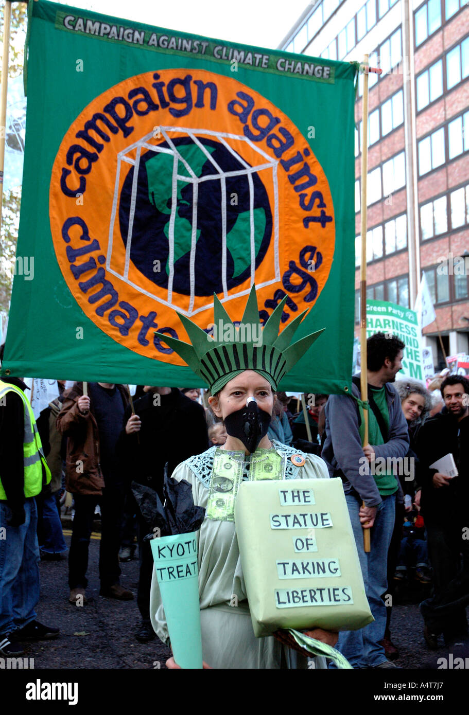 Woman dressed as Statue of Liberty at Climate Change Environmental protest through central London. - Stock Image