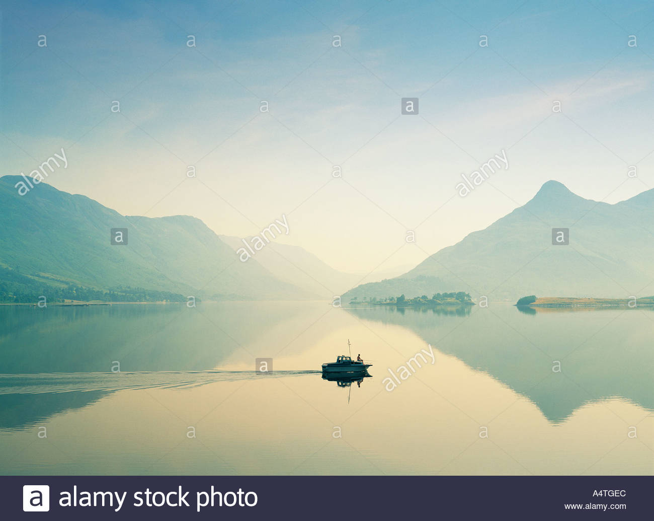 Man saltwater fishing from boat on Loch Leven at north end of Loch Linnhe, Glencoe near Fort William. Highland Region, Scotland - Stock Image