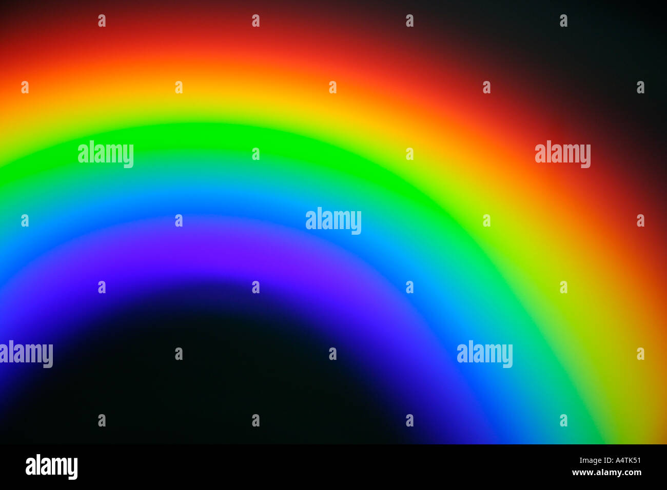 rainbow coloured reflection on surface of compact disc caused by light diffraction - Stock Image