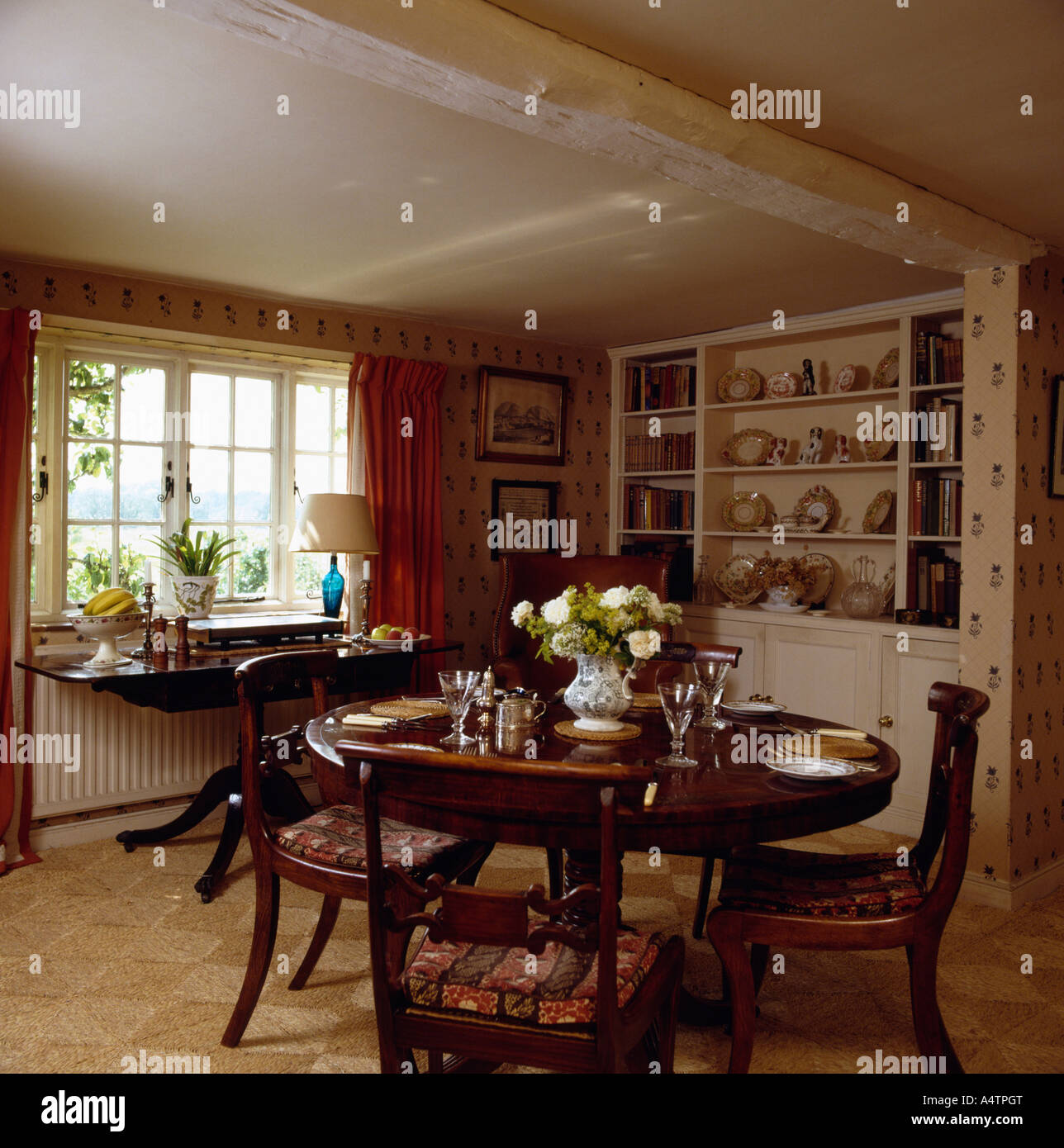 Antique table and chairs in small cottage dining room with ...
