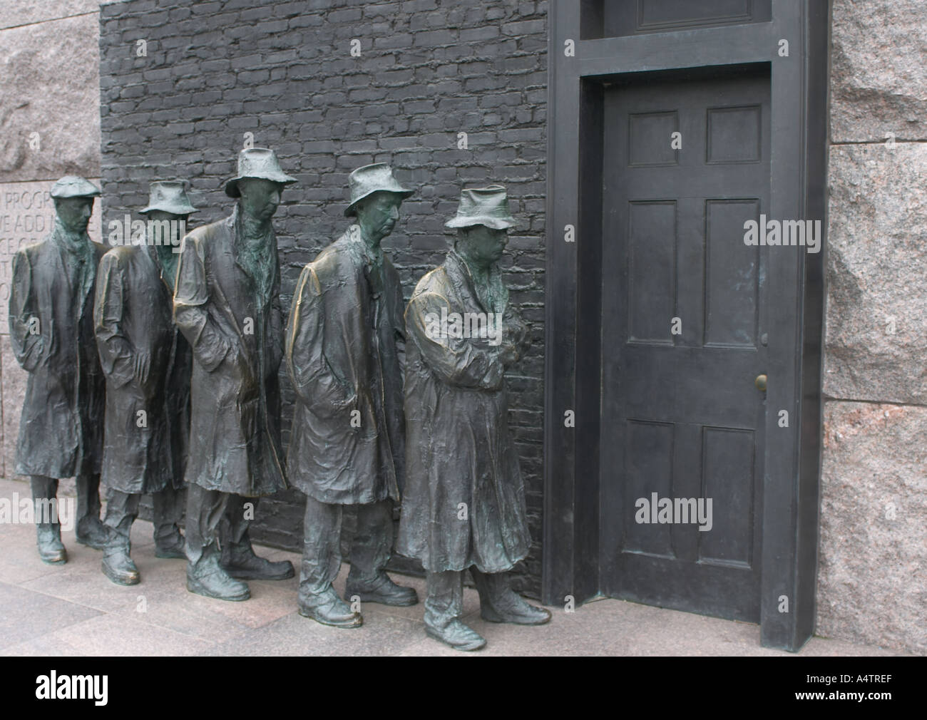 Statue of people in line maybe a bread line soup kitchen line or a work line FDR Memorial Washington DC - Stock Image