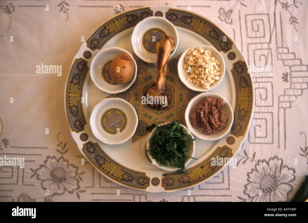 Seder plate  is a central observance  on the Jewish Passover table - Stock Image