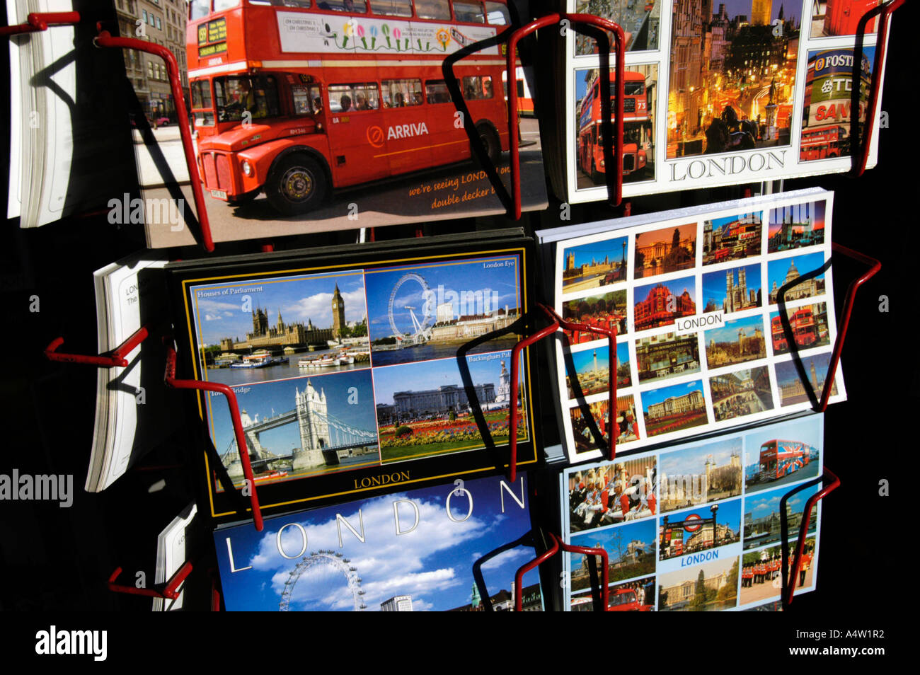 Postcards on display rack of famous London sites, England UK - Stock Image