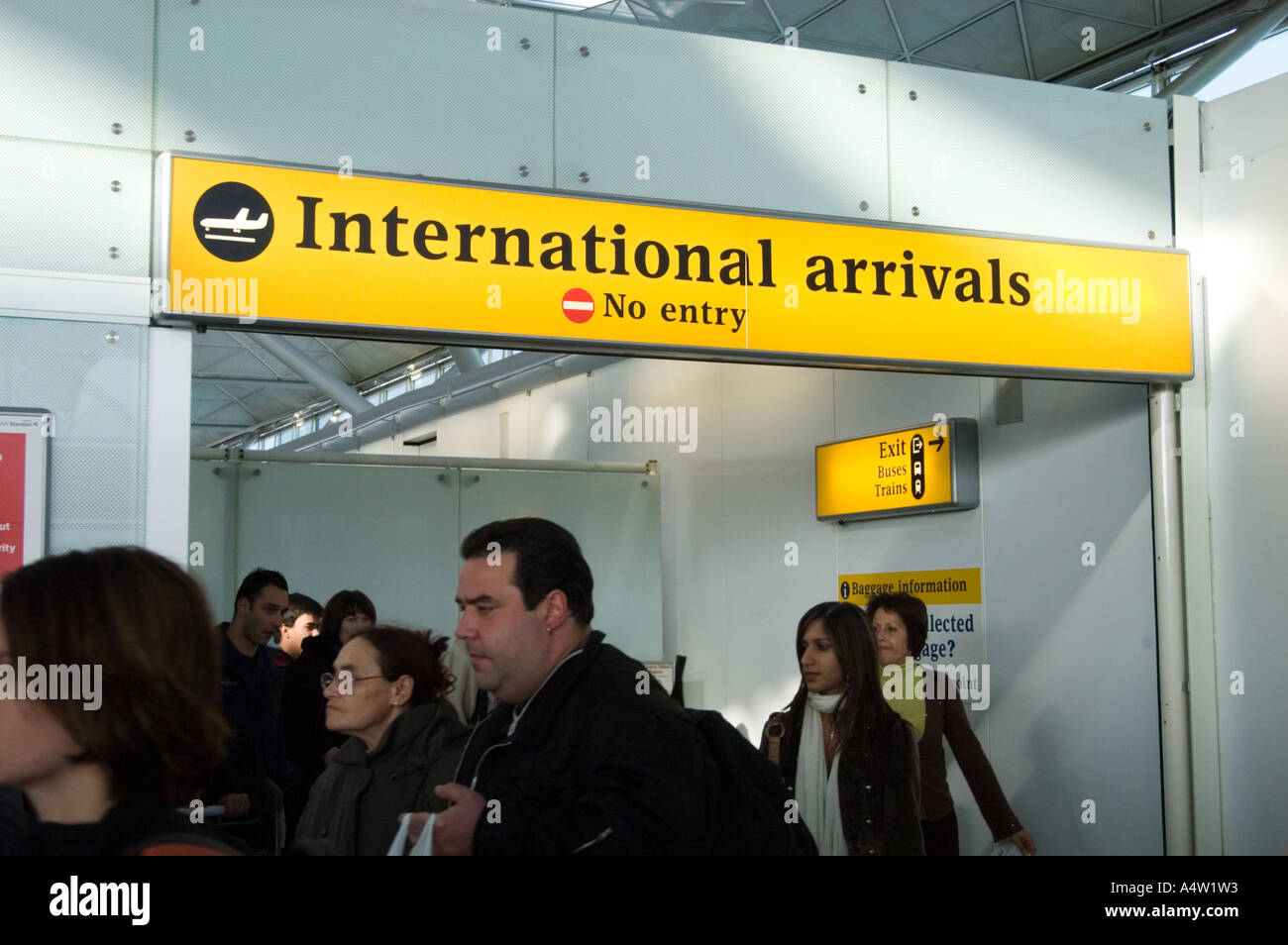 Passengers passing through International Arrivals at Stansted, England UK - Stock Image