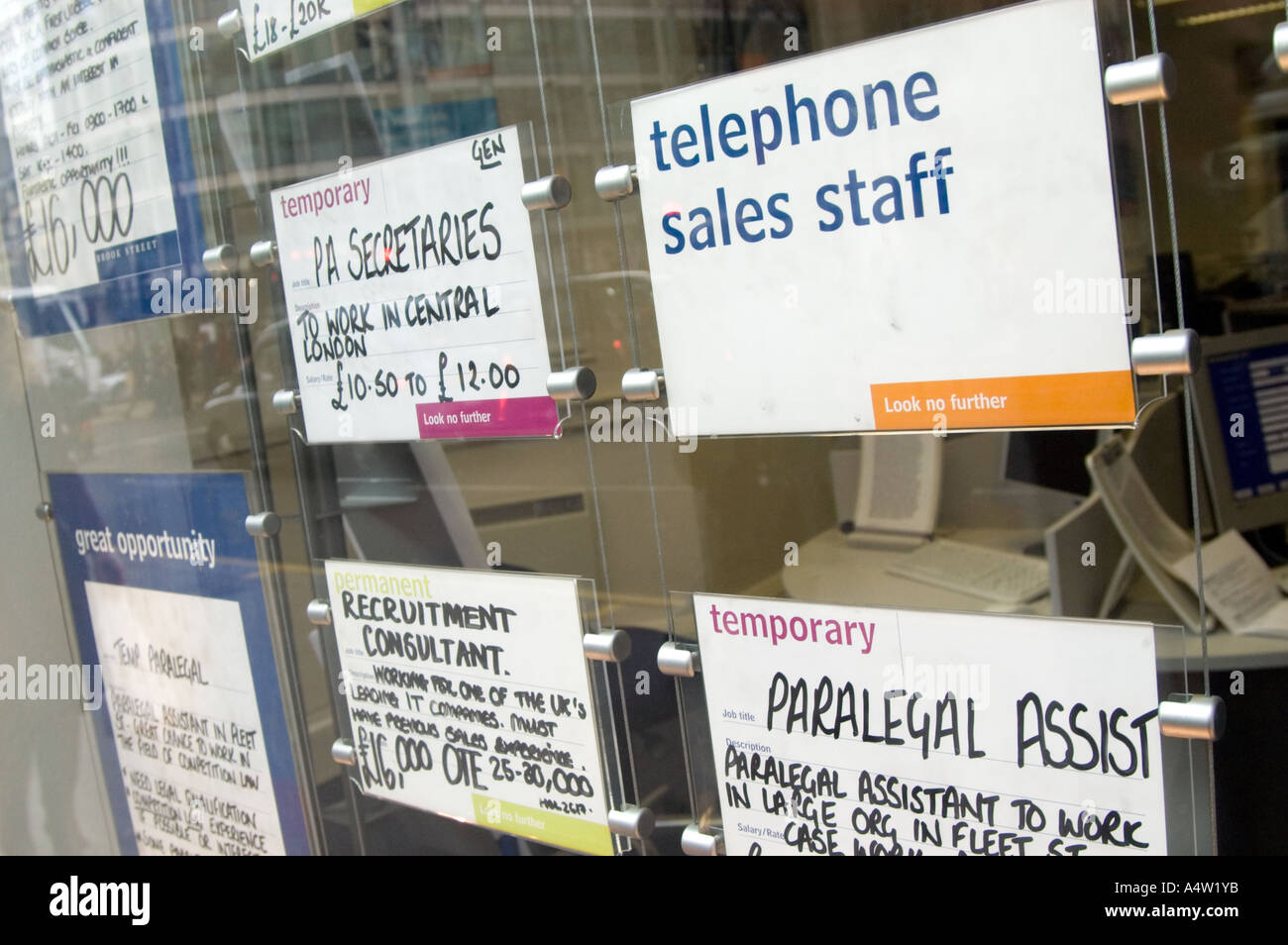 Ad agency stock photos ad agency stock images alamy telephone sales staff job ad in window of office recruitment agency london england malvernweather Gallery