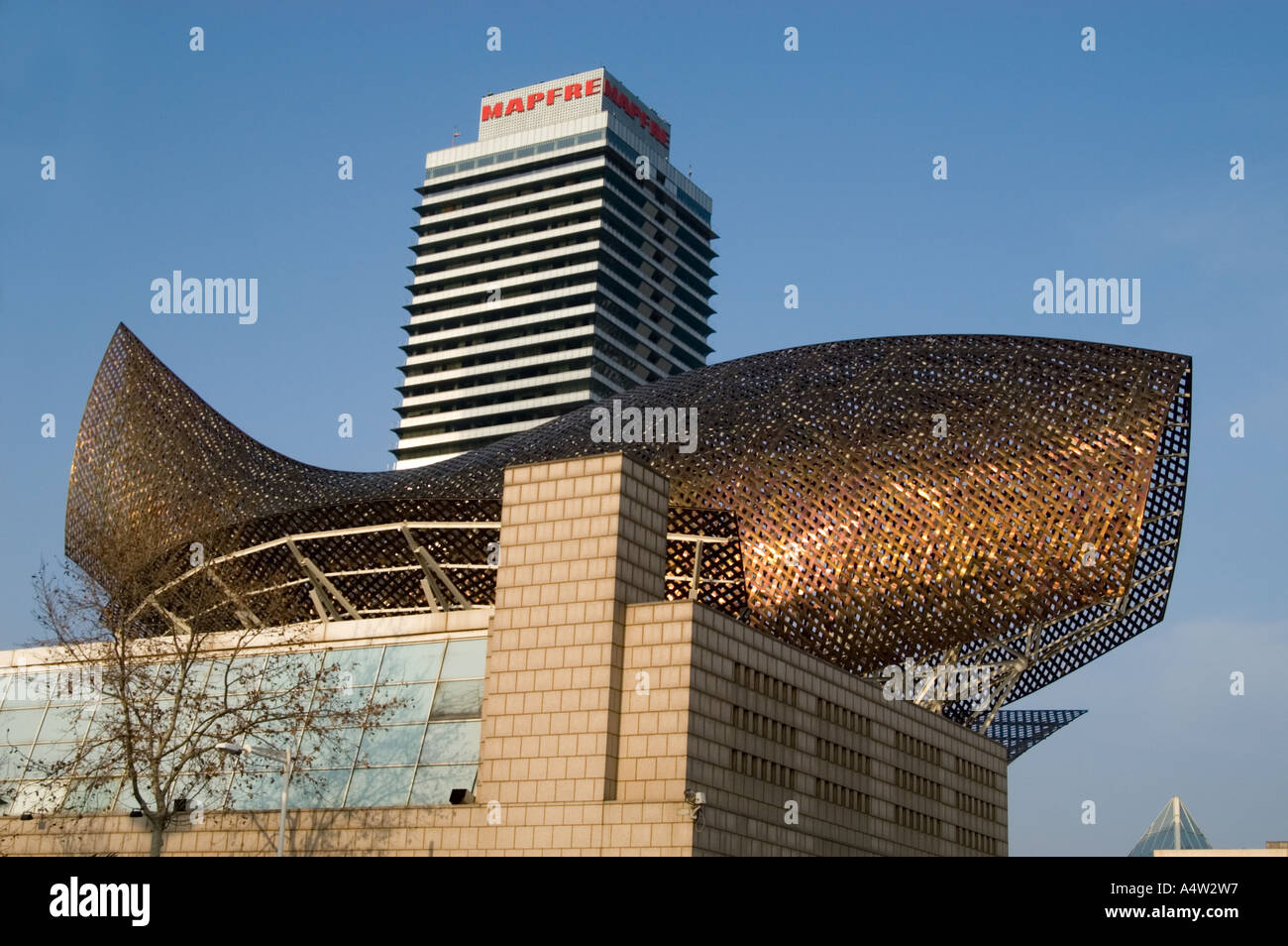 Fish sculpture by Frank Gehry at Port Olimpic in Barceloneta, Barcelona Spain - Stock Image