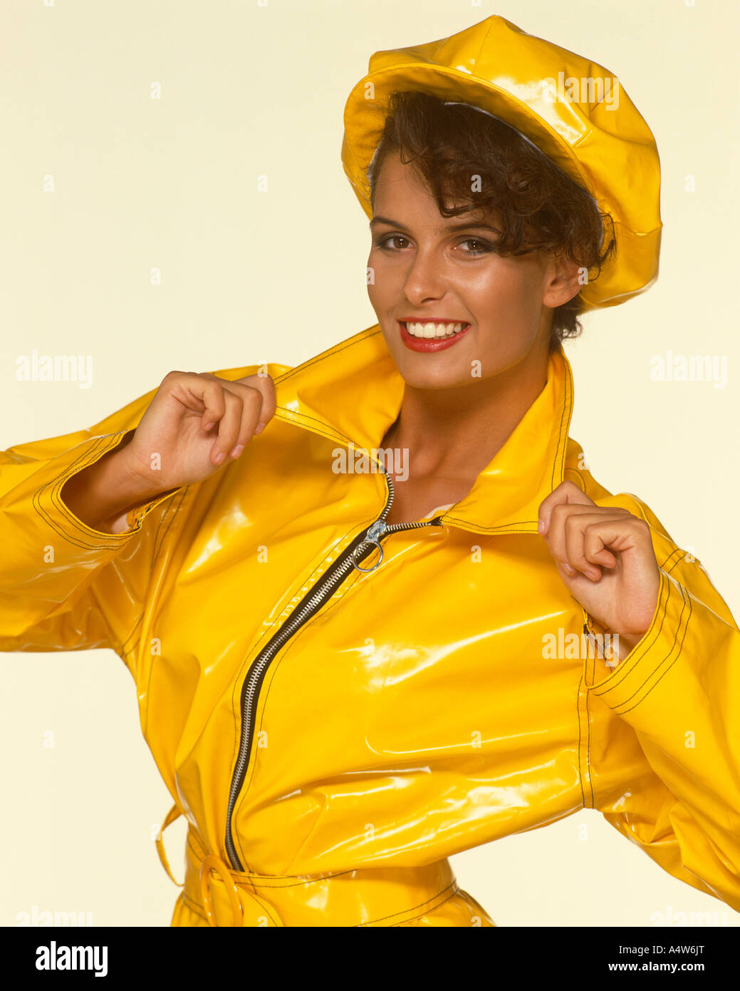 CLAIRE LOUISE YELLOW MAC AND HAT - Stock Image