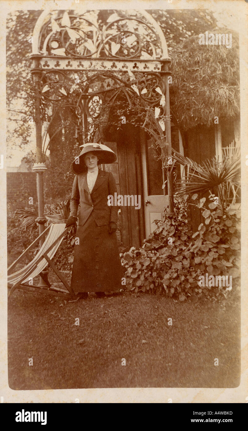 Sepia photograph of unknown Victorian or Edwardian lady in a summer garden - Stock Image