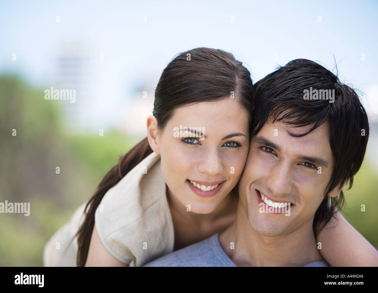Young couple smiling, cheek to cheek Stock Photo