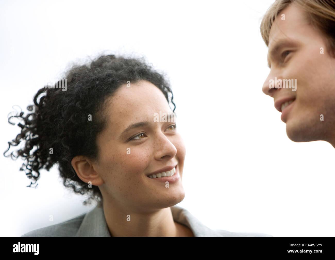 Woman and man conversing - Stock Image