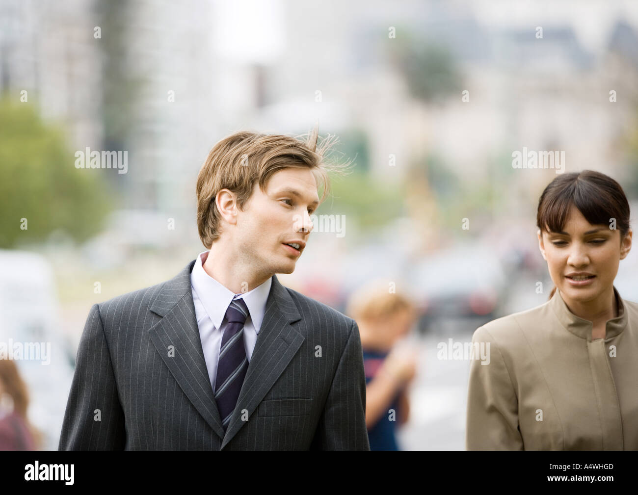 Businessman and woman chatting together - Stock Image
