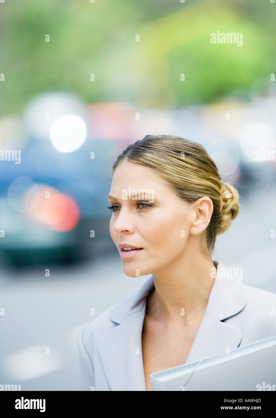 Businesswoman with file folder - Stock Image