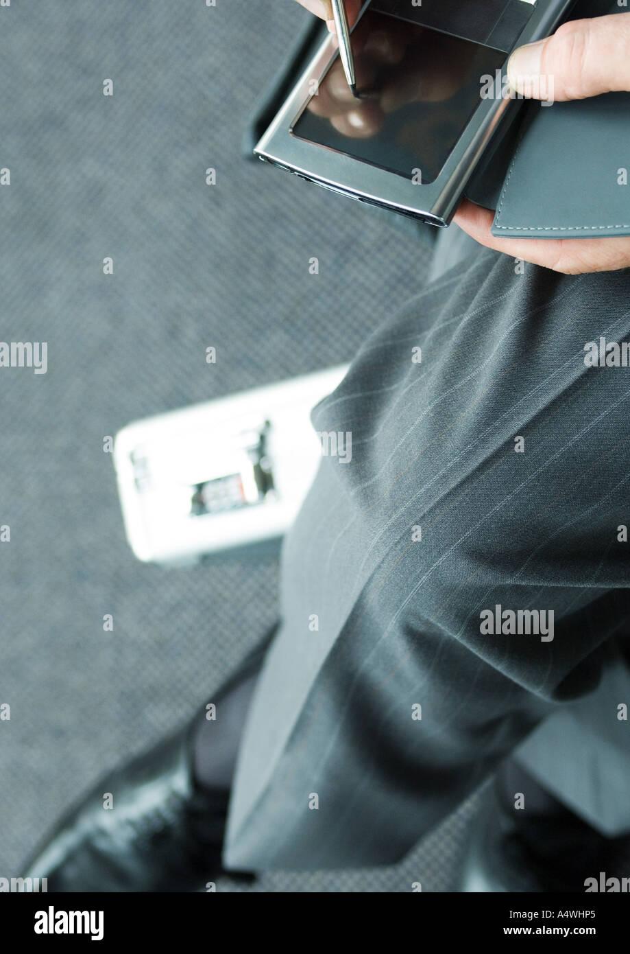 Man using PDA - Stock Image