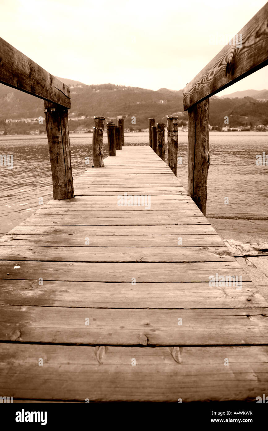 Wooden pier on the lake at Orta San Giulio, Italy - Stock Image